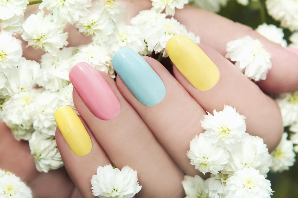 Nails painted with pastel colors