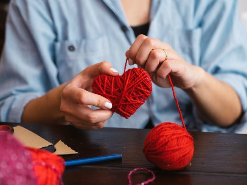 woman knitting a heart