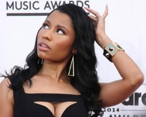 Nicki Minaj scratching her head