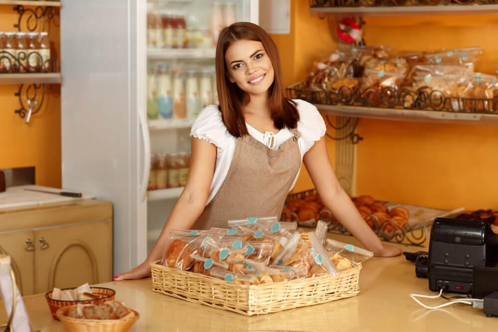 Woman displaying baked goods