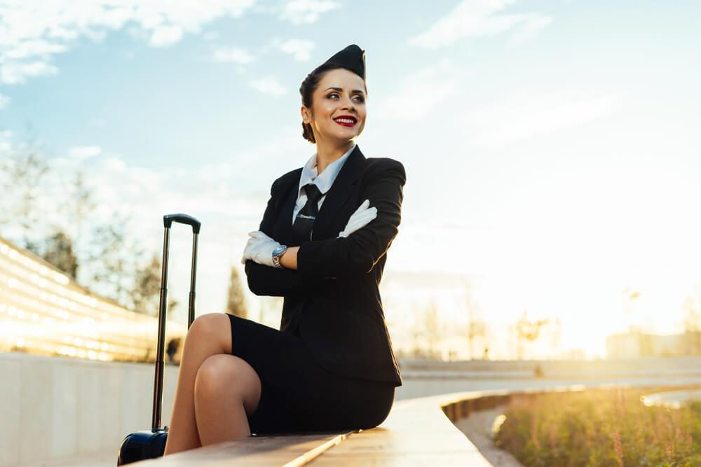 Smiling flight attendant in uniform