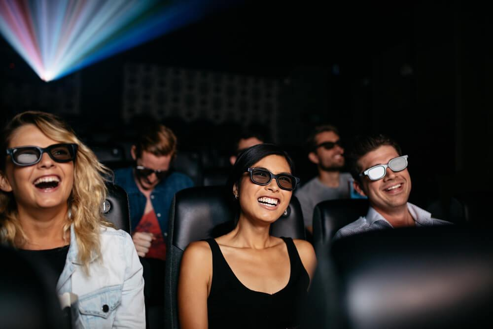 Happy people in a cinema watching an unknown film