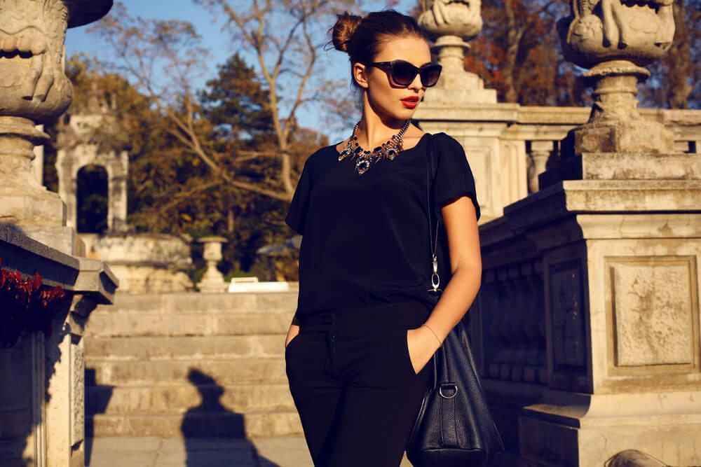 Fashionable woman with sunglasses at sunset