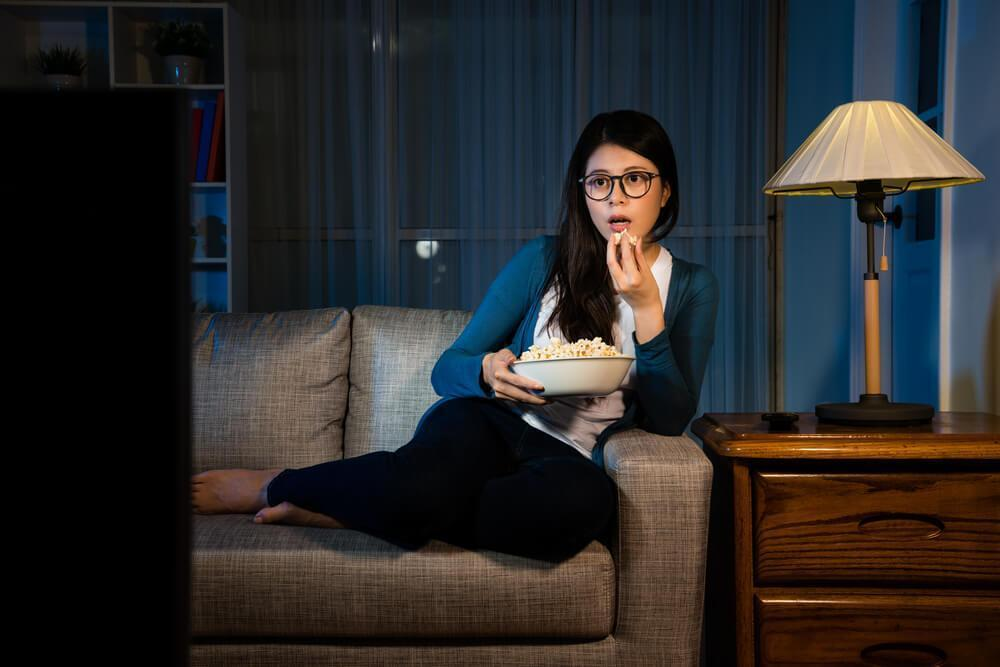 Woman watching a film at home