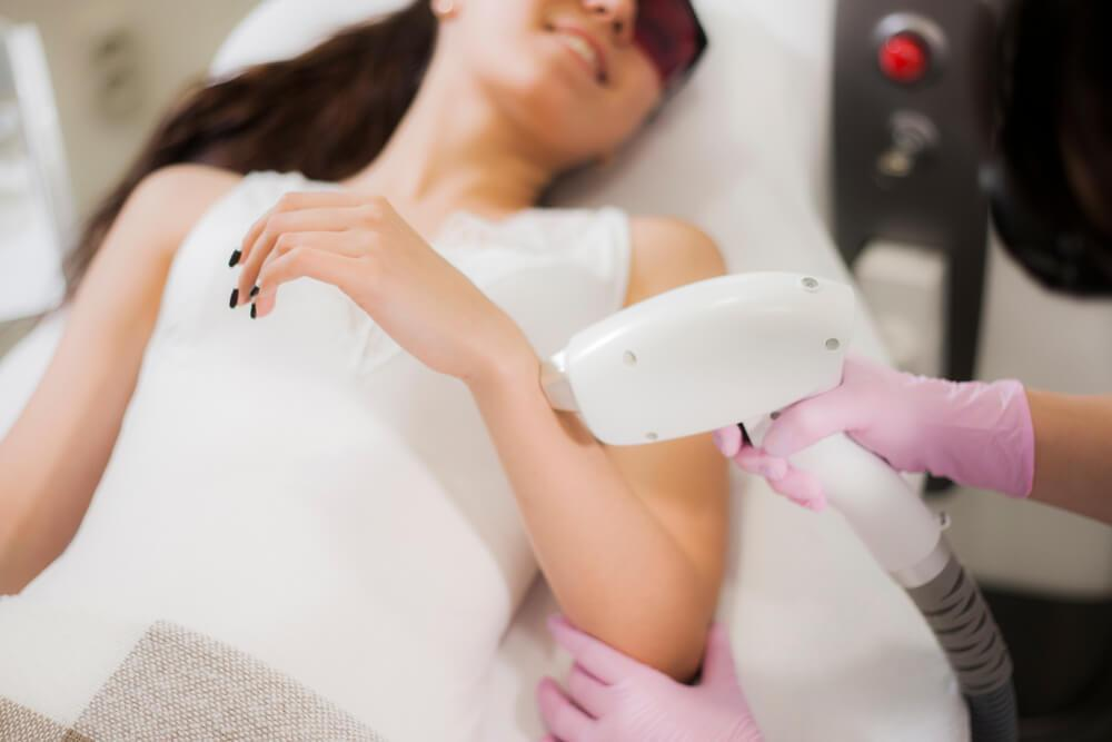Laser hair removal on woman's arm