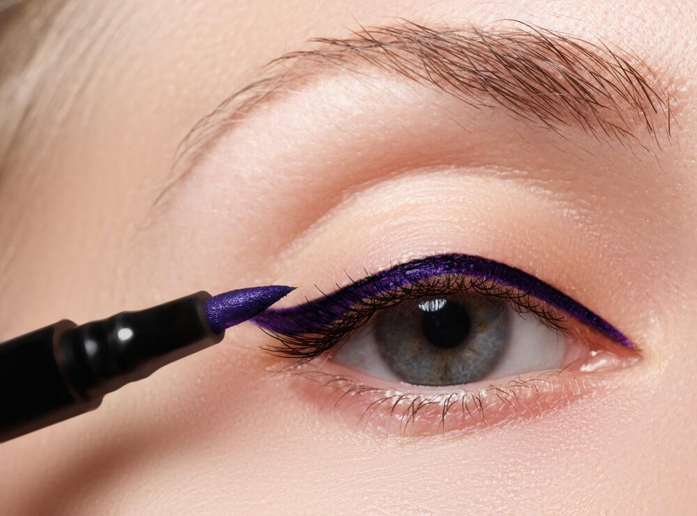 Close-up of purple eyeliner on eyelid