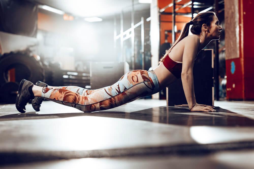 Woman doing burpee workout
