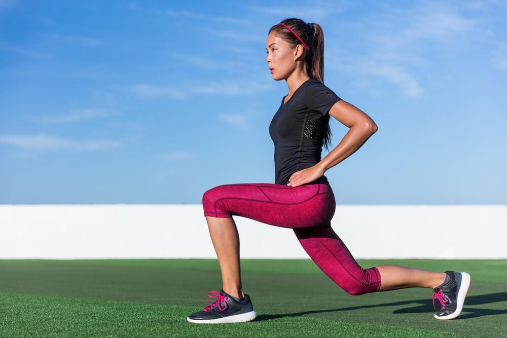Woman doing forward lunges