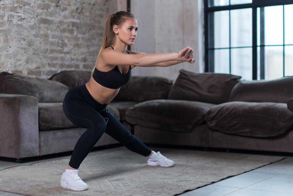 Woman doing lateral squats at home