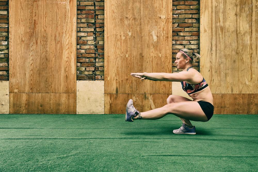 Woman doing the pistol squat exercise