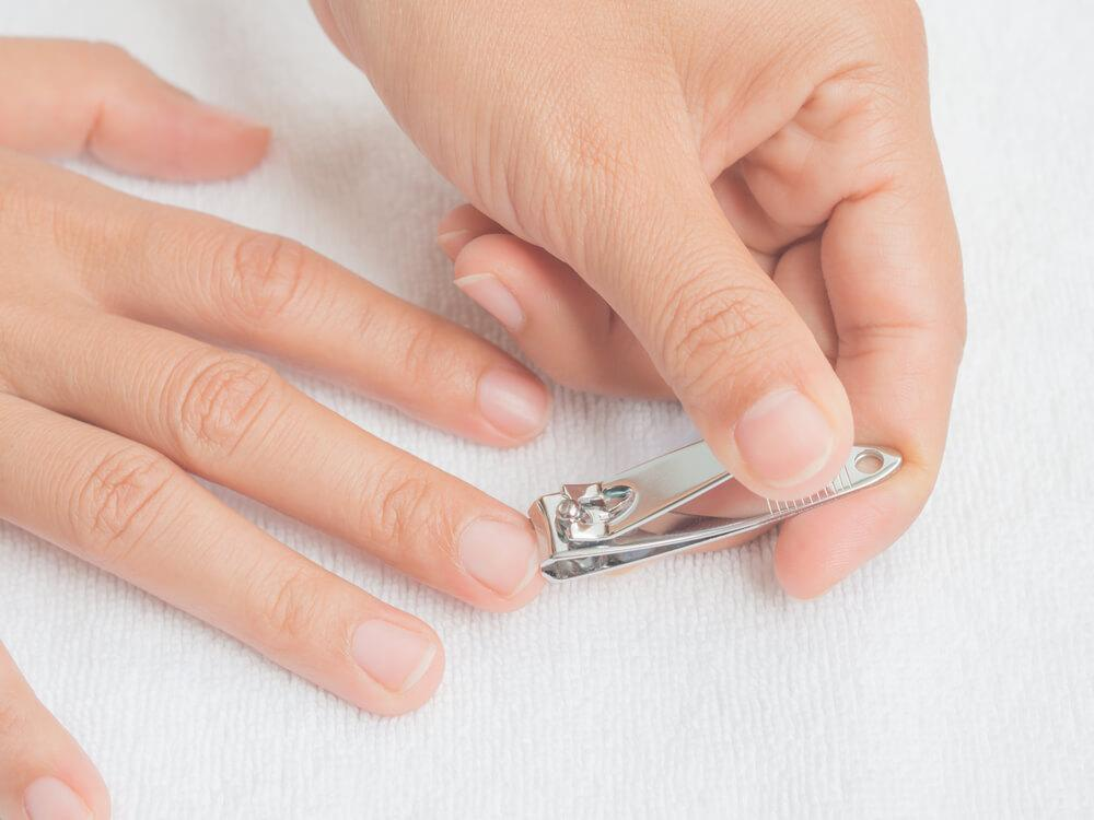 Trimming fingernails with clippers
