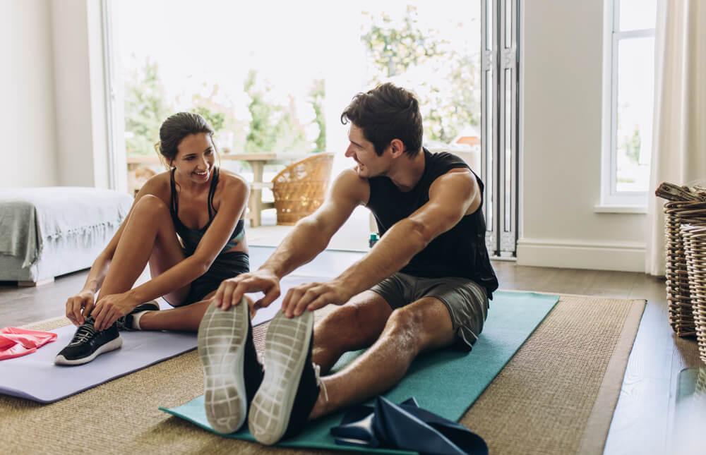Woman and man exercising at home