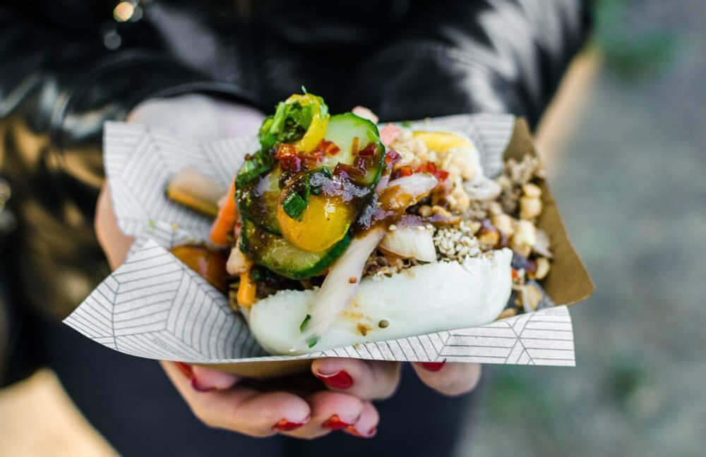 Woman holding street food dish