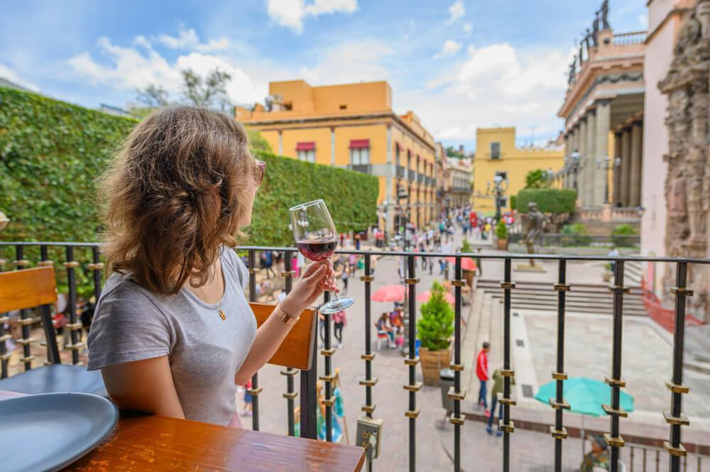 Woman drinking wine in Mexico