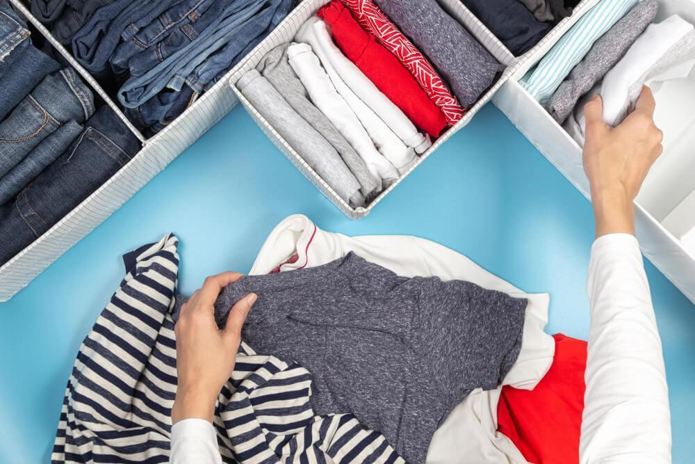 Woman tidying clothes