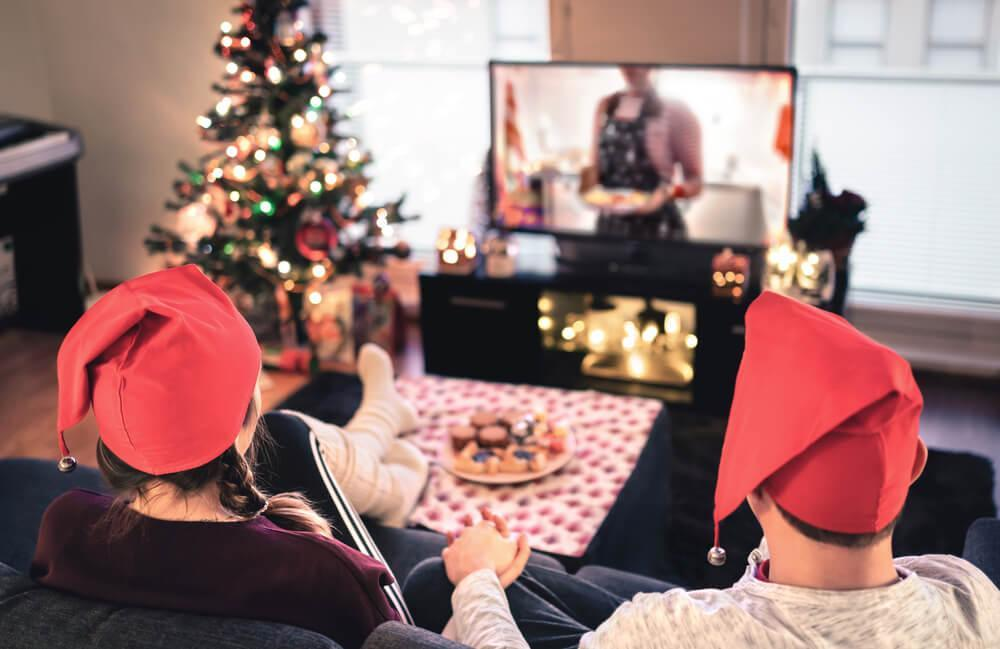 Couple watching TV at Christmas