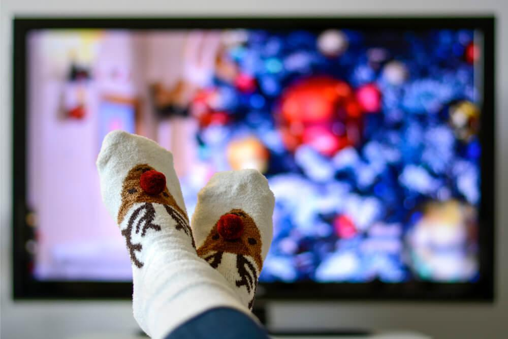 Christmas socks in front of TV