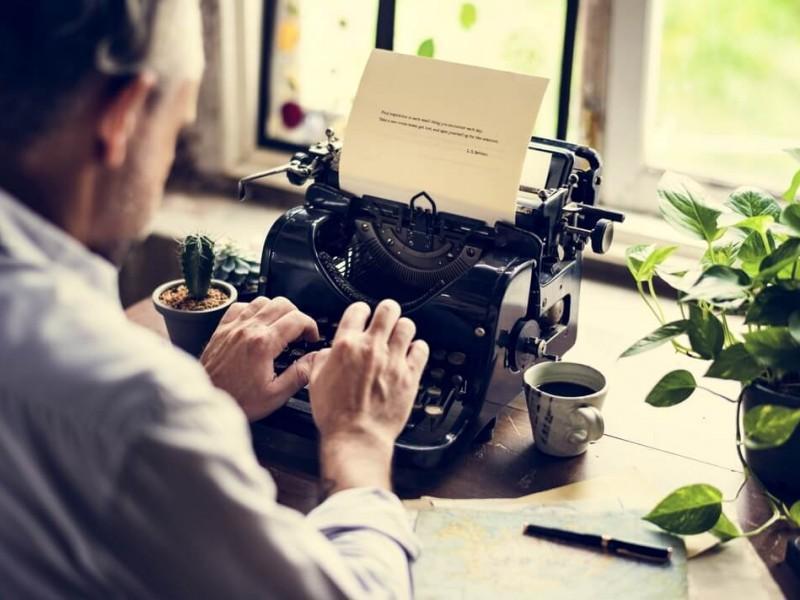 man typing on retro typewriter