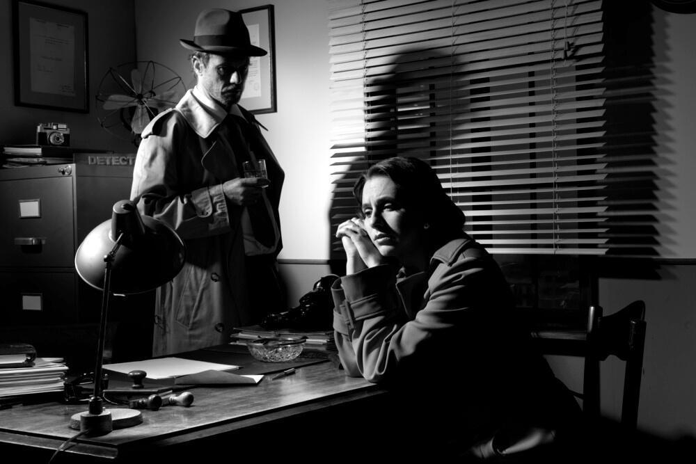 Black and white scene interrogation scene from generic film noir