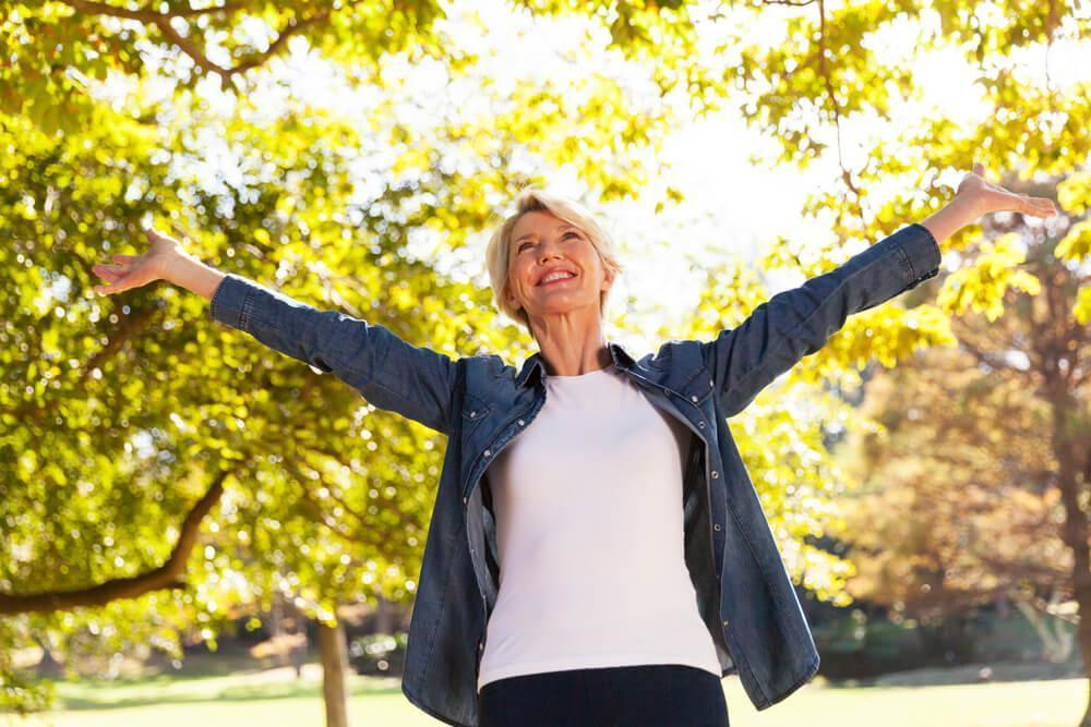 Happy smiling woman with her arms outstretched