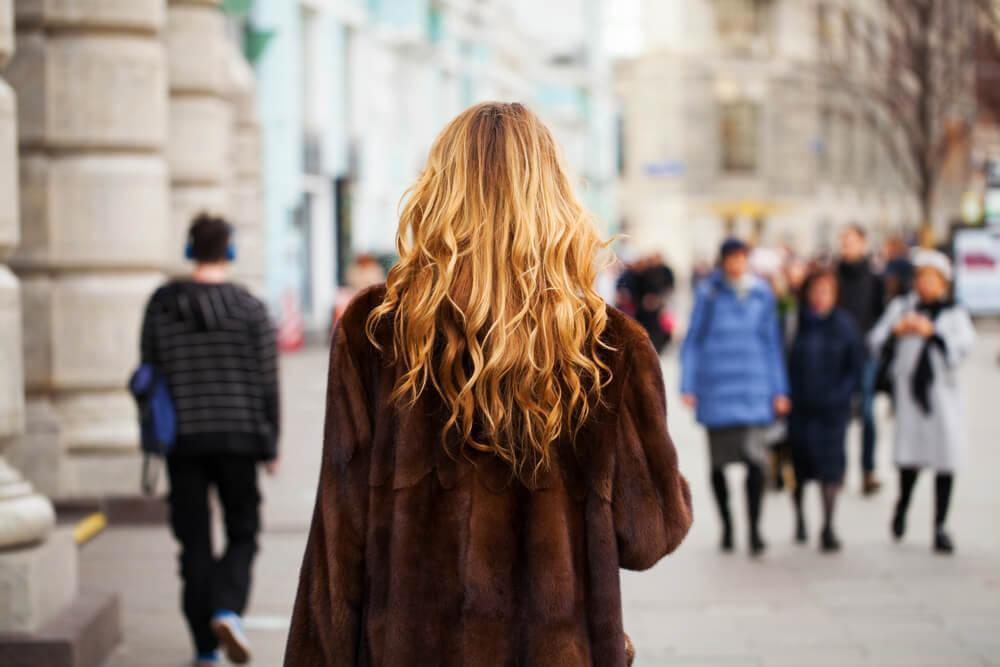 Woman with blonde wavy hair from behind