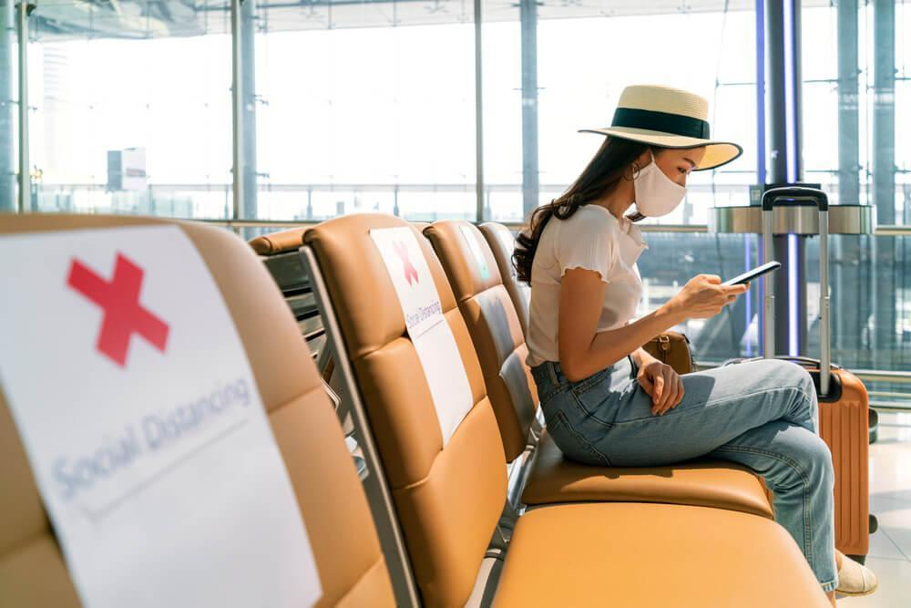 Woman with face mask at airport